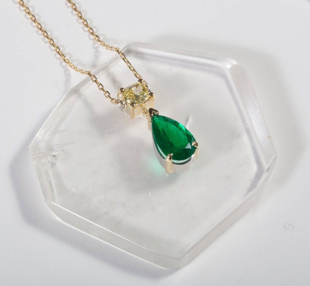 Pear Shaped 1.95ct Emerald and .58ct Yellow Diamond Pendant set in 18k Yellow Gold and Platinum $15,900