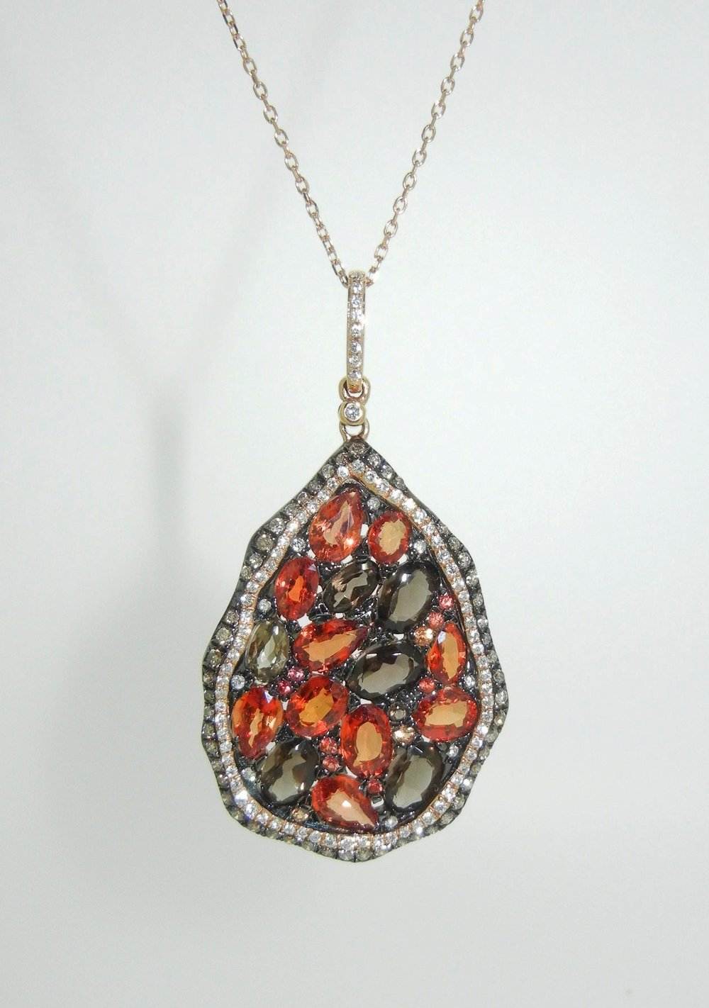 Sapphire, Diamond, and Quartz Pendant set in 18K Rose Gold $3,350