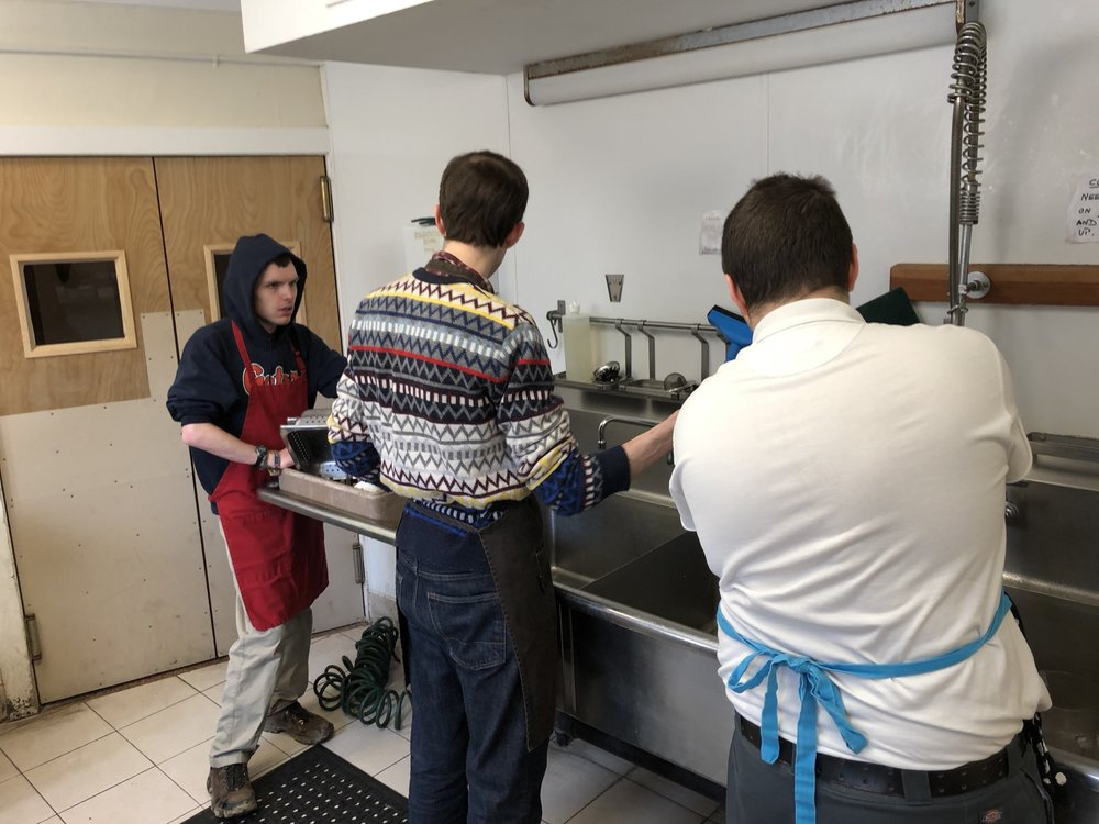 Dustin Sweeney working with Marcus and Andy in the kitchen at The Fellowship, a Senior Living Facility on the Otto Specht/Threefold campus