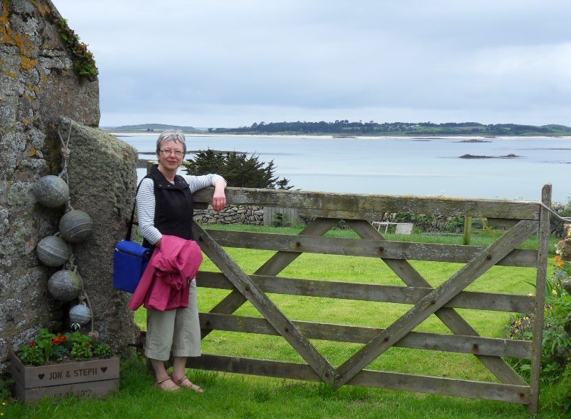 """What a lovely surprise and a fabulous start to the New Year.    David and I are due in the Isles of Scilly at the end of May for 2 weeks so we will certainly be spending some of our win in the local shops and restaurants when we visit.  I have attached a photo of myself in St Martins looking out to Tresco."""