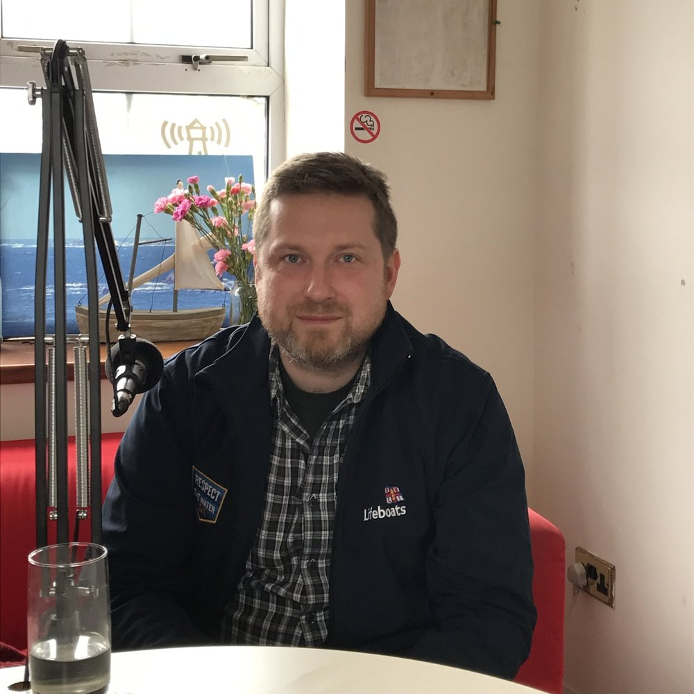 Photographer Jack Lowe talking about The Lifeboat Station Project with Will at the Radio Scilly Studio.