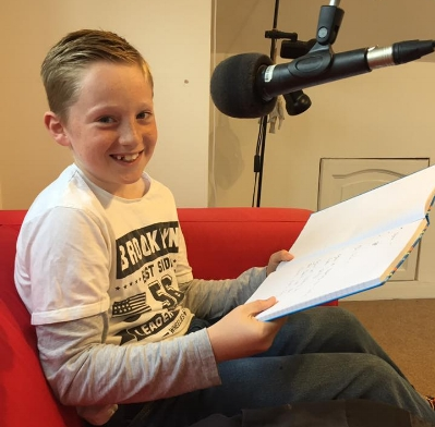 Jacob Mallon talking to Zoe in the Radio Scilly studio.