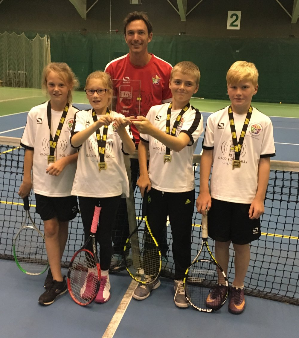 From left to Right: Jessie Jenkins, Ruby May, Ashton Littlejohn and Fred Garman with PE Teacher Adam May at the Tournament in Bodmin.