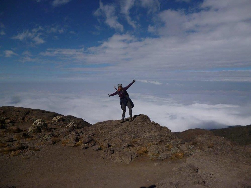 Rachel Pearce at the summit of Mount Kilimanjaro. Images courtesy of Rachel Pearce.