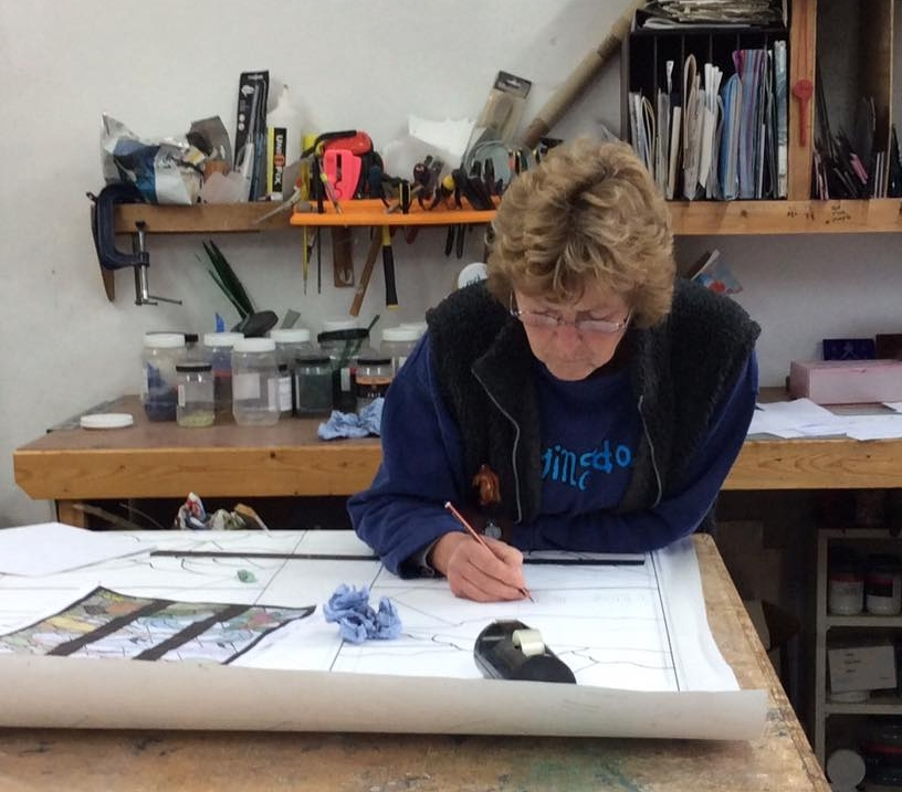 Oriel concentrating on stained glass window design. Image courtesy of Phoenix Craft Studios.