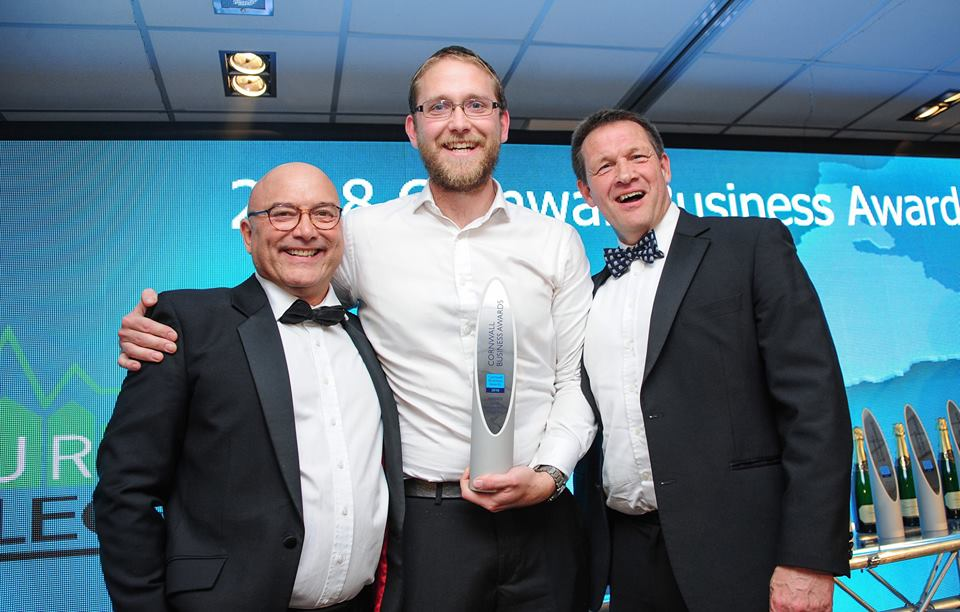 Aiden Hicks (centre) receiving the Young Business Person of the Year award from Celebrity Chef and MasterChef co-host Gregg Wallace (left).