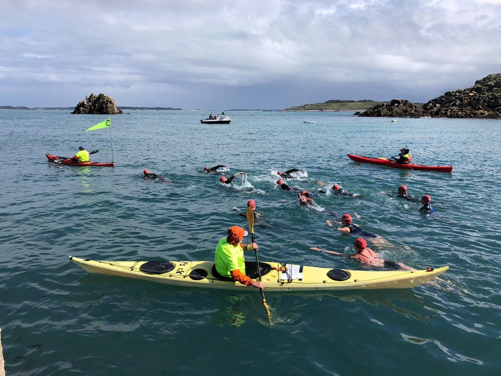 Swimmers and support staff heading off from St Agnes. Image courtesy of Scilly Swim Challenge.