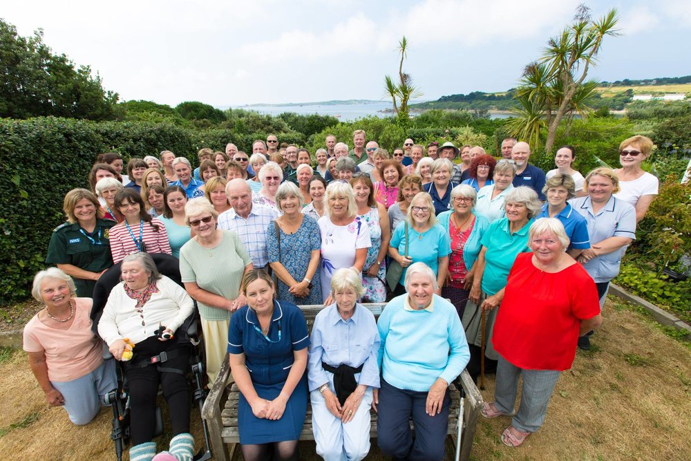 Isles of Scilly NHS staff past and present in the Health Centre garden on St Mary's. Image courtesy of Chris Hall Photography UK.