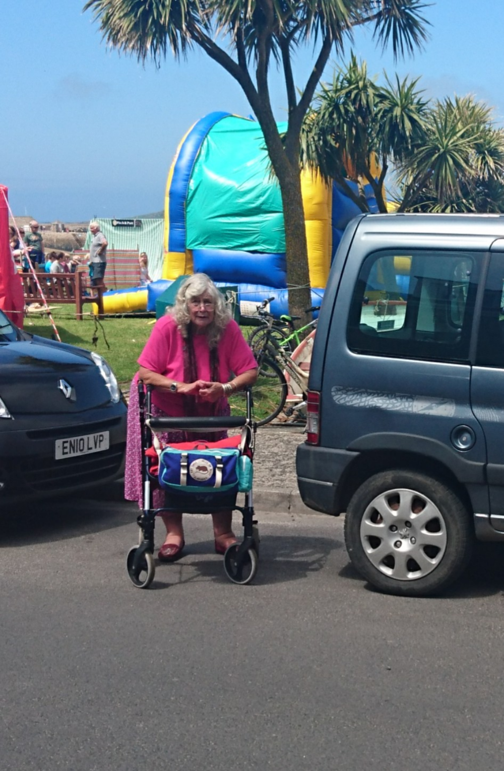 """This photo of my Mum with her walker was taken last year at the end of May (bank Holiday weekend) on the fun day on the green, where we just popped over for the day after spending 6 1/2 weeks a few weeks before."""