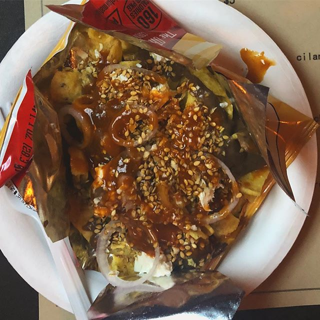 A next to perfect dish...EN-FRITO-Ladas | bag o' Fritos, salsa de frijol, queso panela, crema, shallot sesame and chili oil 🔥