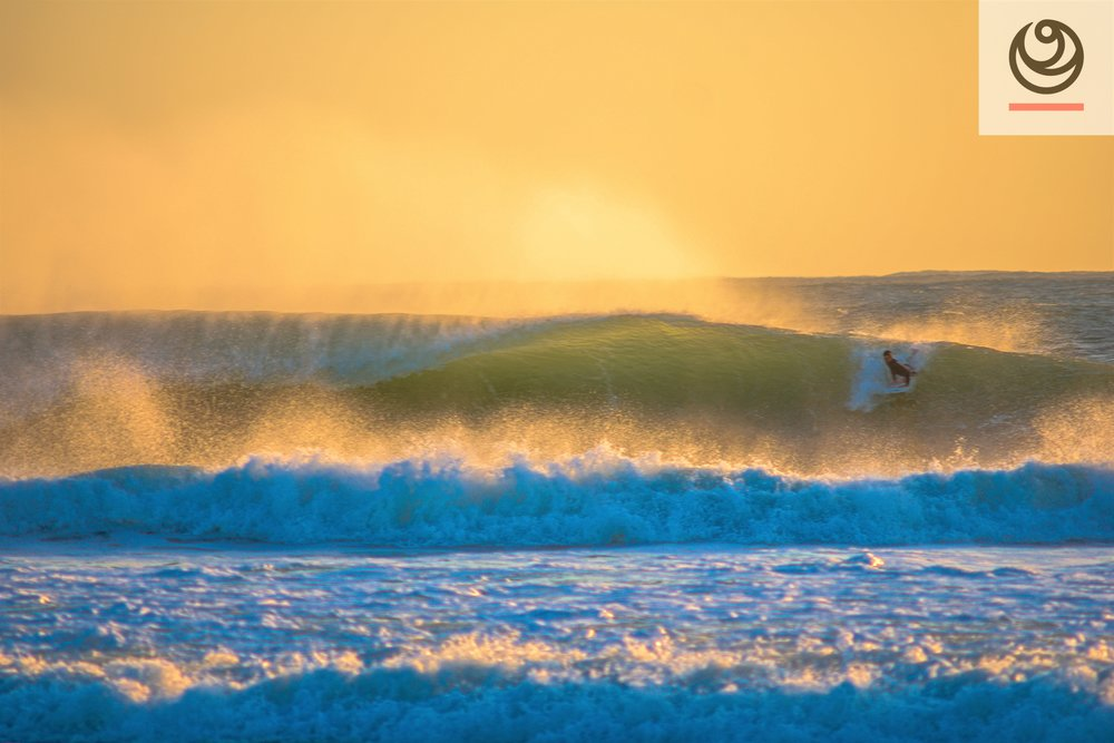 Supertubos doing its thing at sunset. There's easier waves around too!