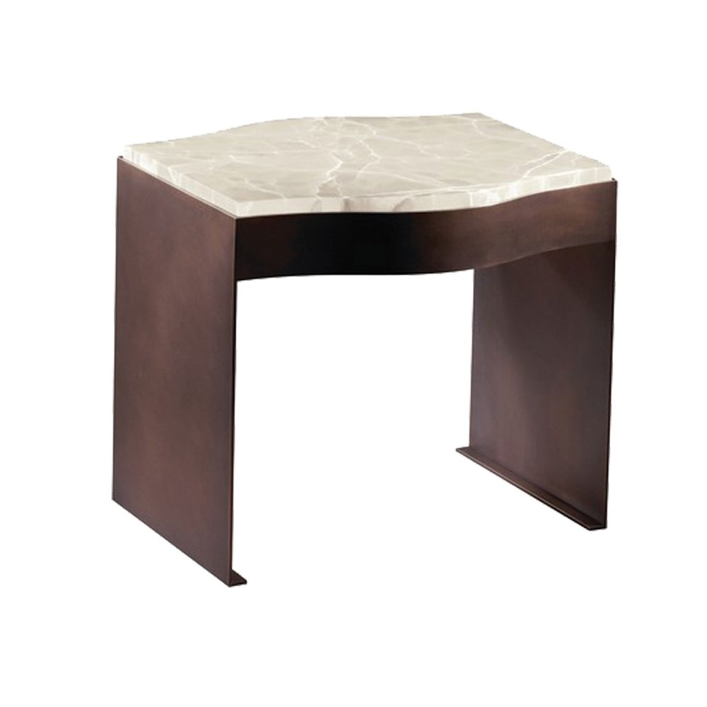 A lovely side table from Donghia that is smaller scaled. The bronze base has a beautiful onyx top. This would work well between two smaller scaled chairs in a living room or beside a chaise in a bedroom. Available to the trade.