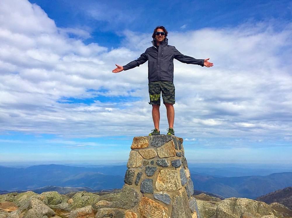 Standing on the summit of Kosciuszko, Australia – 7,310' (2228m)