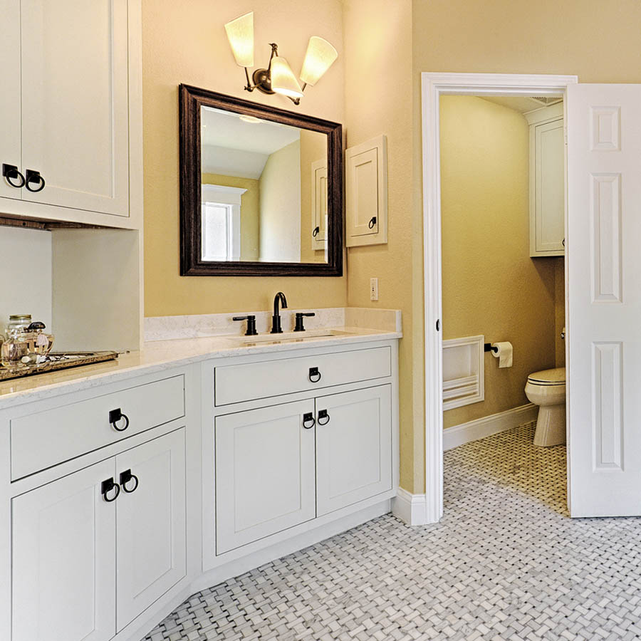 Lighting and paint are great places to get creative in a bathroom as both can easily be changed. New lights and a new coat of paint could transform the look of this traditional and classic bathroom.