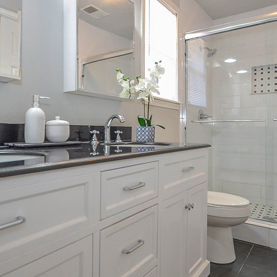Chrome is a classic finish that looks great with Black + white, as used here in this budget master bathroom remodel.
