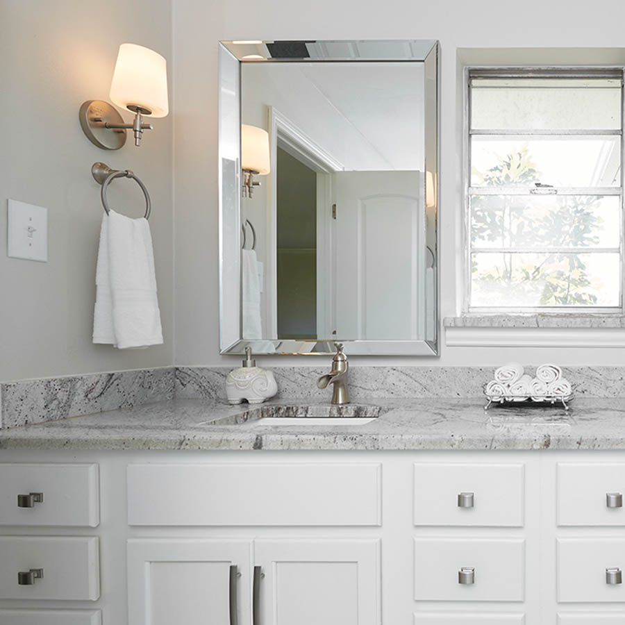 A nickel waterfall faucet helps create a spa feeling in your master bathroom remodel.