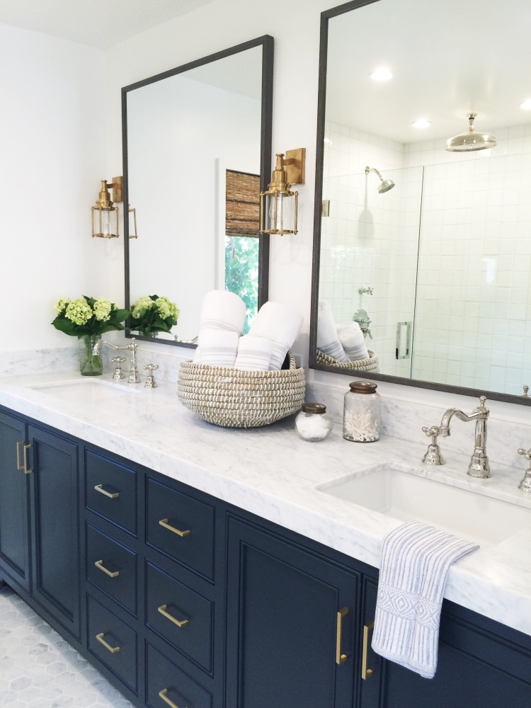 from Mindy Gayer Design Co - beaded inset cabinets paired with a square or laminated edge are a great example of transitional design. Note the gold pulls, brass sconces and nickel faucet - no need to maktch all the finishes and it looks gorgeous.
