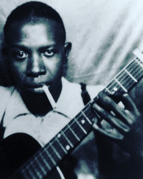 "Robert Johnson had the myth: He gave his soul to the devil, and the devil gave him the blues. But he never had the money, and neither did his descendants. Johnson died at the age of 27 in 1938; nobody thought much about his copyrights until a record-shop owner called Larry LaVere took an interest 30 years later, and persuaded Johnson's half-sister to sign away her rights. LaVere turned Johnson's recordings into an evergreen best-selling CD set. ""LaVere got a deal such as nobody I've ever heard of getting in the history of the business. I have no axe to grind with him, but it boggles the mind."" ___________ From Memphis Rent Party: The Blues, Rock & Roll in Music's Hometown by Robert Gordon  __________ #blues #music #musician #robertjohnson #crossroads #mississippi #legend #icon #history #instagood #story #stories #thestorybar #photography #portrait #blackandwhitephotography"