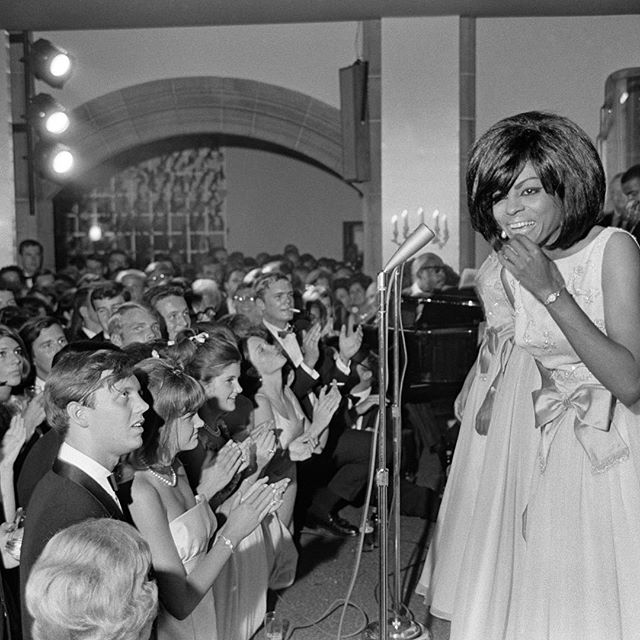 "In June 1965, the Supremes, one of America's biggest and most glamorous groups, performed at a debutante party at the Country Club of Detroit in Grosse Pointe, Mich., the posh all-white enclave just northeast of the city.  The three elegant darlings of Detroit, led by the 21-year-old Diana Ross, serenade a room of finely attired guests, many of practically the same age. But between the groups were also the realities of race and class — the distance between Grosse Pointe and the Brewster projects where the Supremes grew up, 10 miles and several worlds away.  ___________ From ""For One Night in 1965, the Supremes Brought Two Detroits Together,"" by Alexis Clark for the New York Times; Photo by Allyn Baum  ____________ #motown #detroit #michigan #grossepoint #race #blackandwhitephotography #supremes #dianaross #queen #icon #music #rock #pop #story #stories #thestorybar"