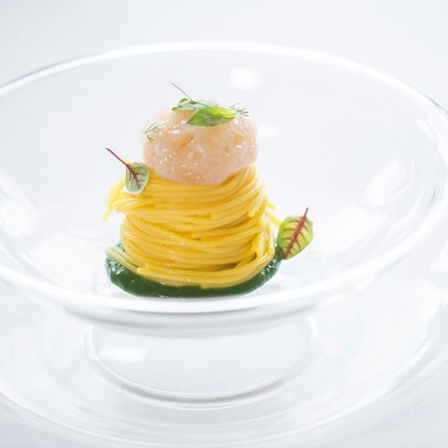 """Cold spaghetti Km 4925"" is a signature dish at Ristorante La Siriola in the Dolomites. Graduating from Mr. Niederkofler's St. Hubertus kitchen, Matteo Metullio took charge of La Siriola's decades-old restaurant on the same mountain, and in 2017 became the youngest chef in Italy to garner double Michelin stars. While Mr. Metullio's ingredients are more international than his pointedly locavore mentor, his training and proximity ""show how groups of chefs are working to create these high-quality territories,"" says Massimo Bottura, the chef of the world's top-rated restaurant, Osteria Francescana, who fondly recalls the vast bounty of La Siriola's New Year's brunch buffet. A similar buffet feast is served on Sundays, as is the housemade speck Mr. Bottura took home, vacuum-packed to enjoy again in Modena.  ___________ From ""5 Places to Eat in the Dolomites"" by Laura Rysman for the New York Times; Photo by Susan Wright  ____________ #italy #italian #dining #dine #food #foodie #massimobottura #chef #chefslife #dolomites #spaghetti #dish #foodporn #foodphotography #instagood #story #stories #thestorybar #osteriafrancescana"