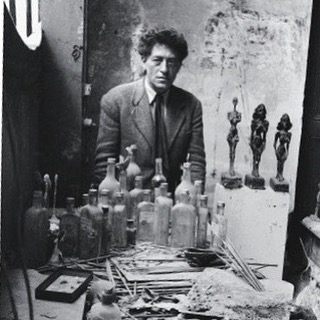 """I keep this Sabine Weiss photo of Alberto Giacometti in my Milan office. I love his slightly off-kilter but always chic personal style. He'd be perfectly dressed in a jacket and tie while lying on the floor to work on a sculpture and end up completely covered in plaster, sand and bronze resin."" ___________ Alessandro Sartori as told to Lindsay Talbot for the New York Times  ____________ #italy #italian #alessandrosartori #albertogiacometti #sabineweiss #fashion #design #art #artist #milan #photo #photography #portrait #blackandwhitephotography #chic #style #instagood #story #stories #thestorybar"