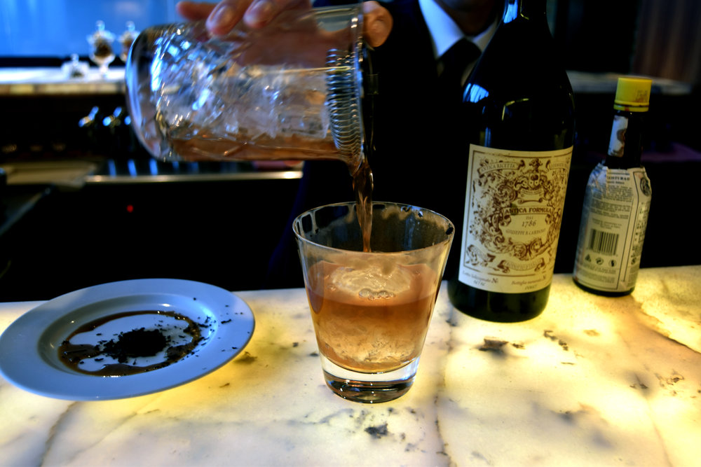 Japanese Negroni: Miyagikyo NV, Antica, Soy and stout syrup glaze, apple juice, dried orange, and roasted tea. You can see the remains of the smoked tea leaves on the left hand side :)