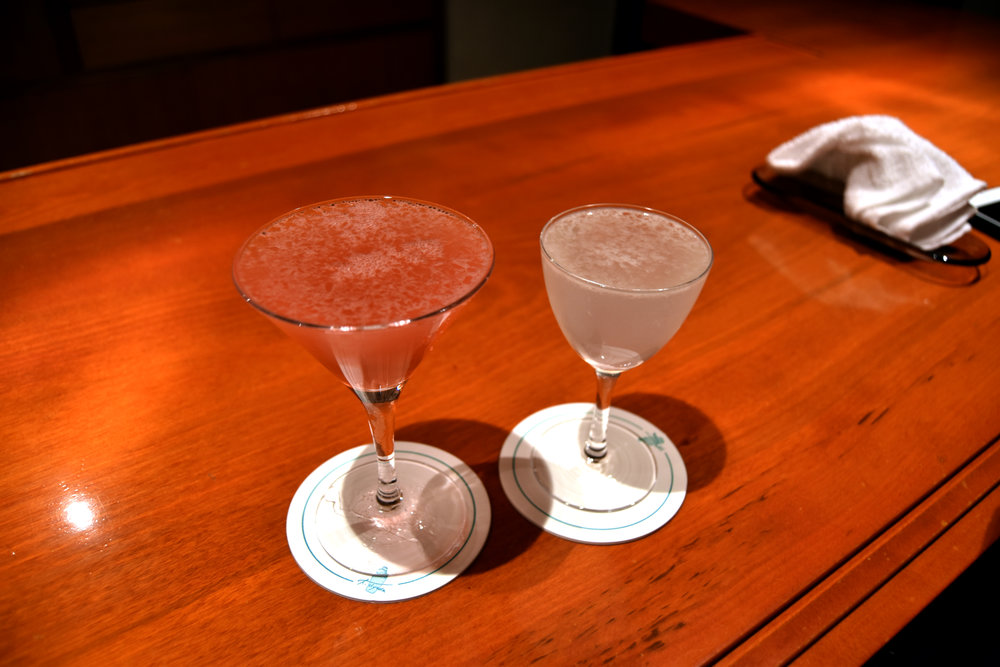 "Left: a off-the-menu cocktail that the bartender made in response to my request for a ""bitter"" cocktail on the menu (there are none). They used some Luxardo bitters for a cranberry-grapefruit tasting cocktail. The right is the XYZ cocktail: rum, triple sec, lemon juice, simple syrup."