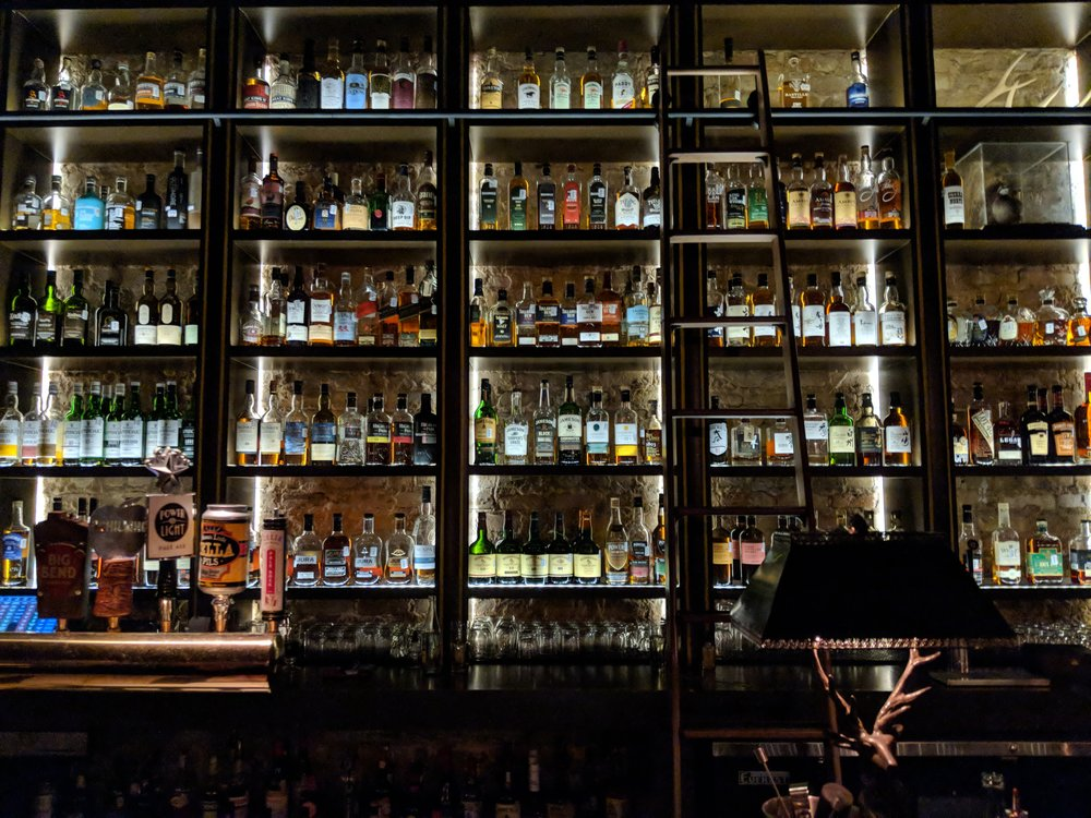 A portion of the luxurious whisky bar at Seven Grand