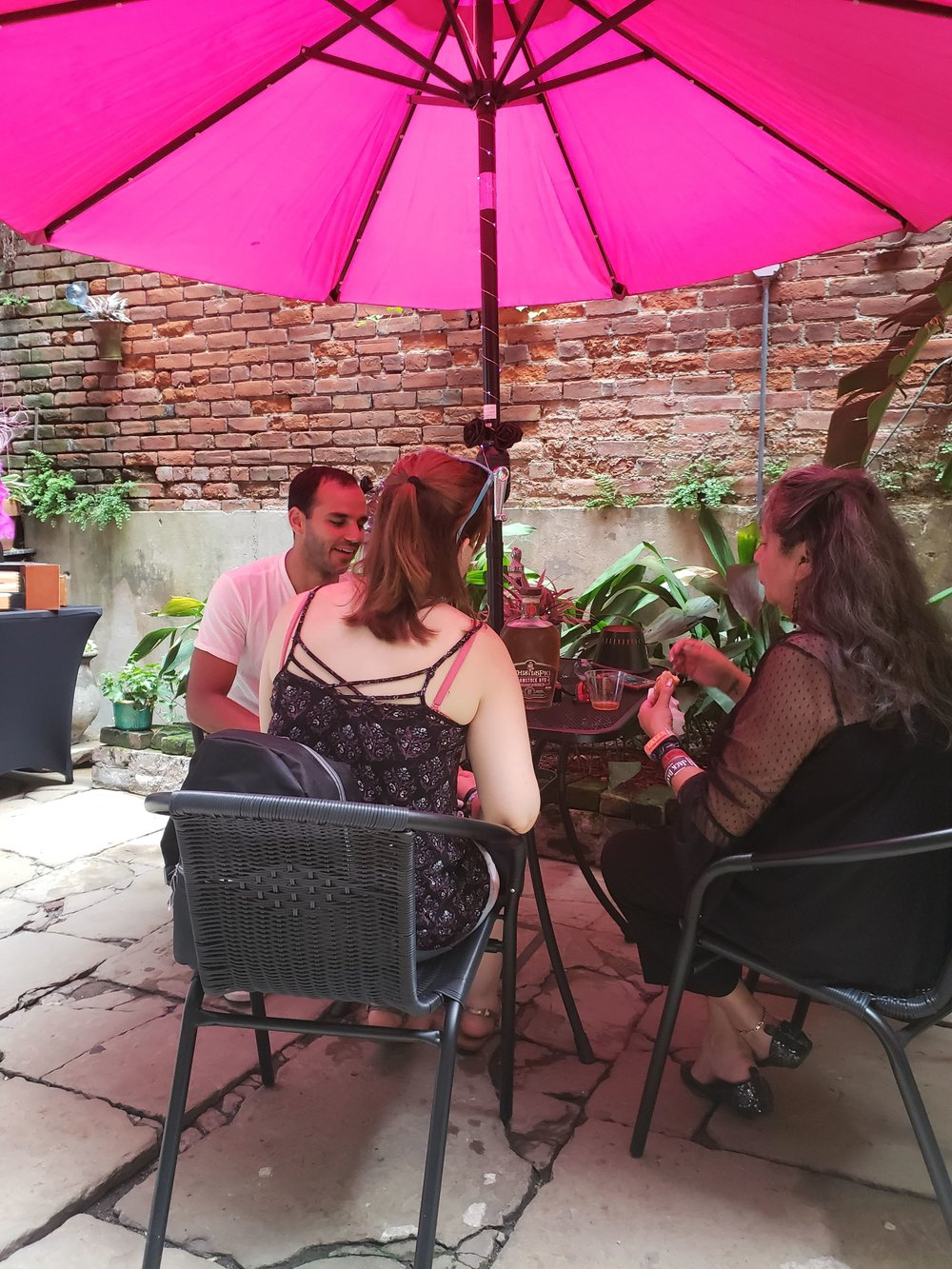 Daniel Kahn entertaining two guests to the WhistlePig courtyard