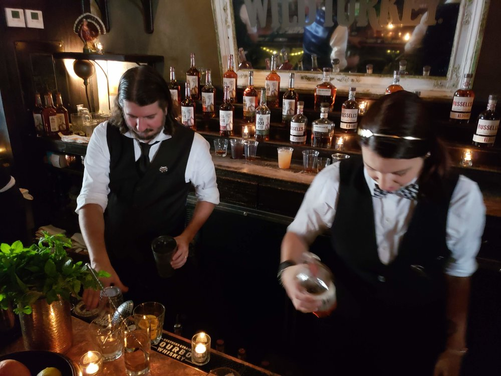 Bartenders mixing bourbon-based cocktails at the Sylvain for Wild Turkey