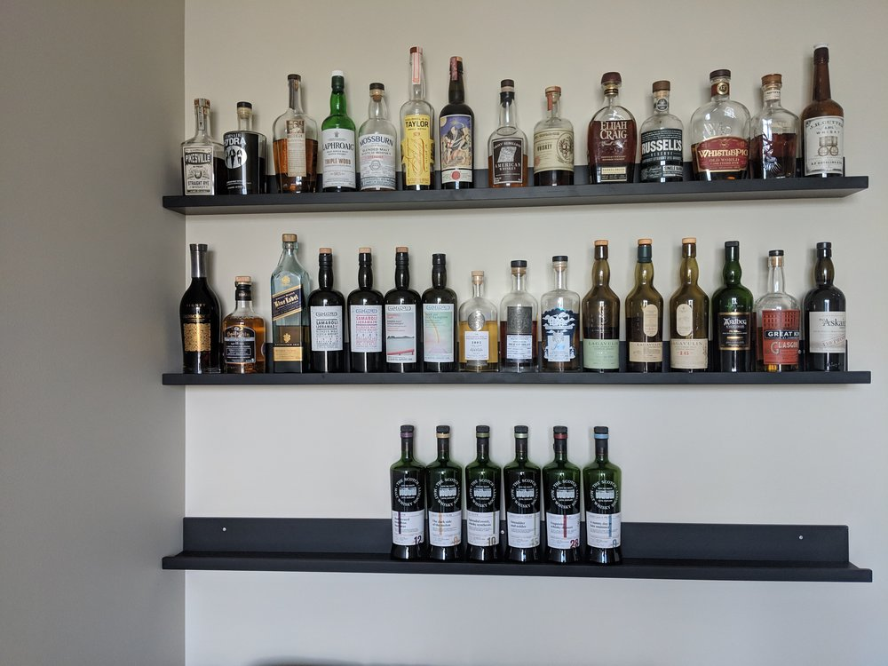 Auxillary shelves for Bourbon and Scotch collections in the whisky room