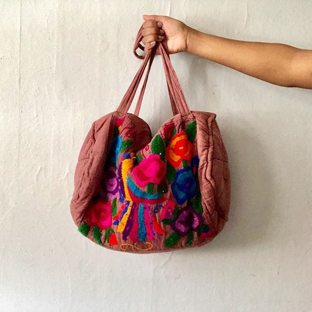 We scooped this bag up a couple of years ago in Mexico City. It's barely used so it's still in great condition. It features hand embroidered flowers and parrots and a beautiful mauve color. It can be used as a travel bag, diaper bag, school bag, or pretty much anything else you want! Click the link in the bio to purchase!✨