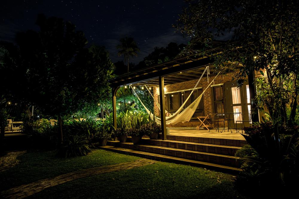 Villa Porch at night with model.JPG