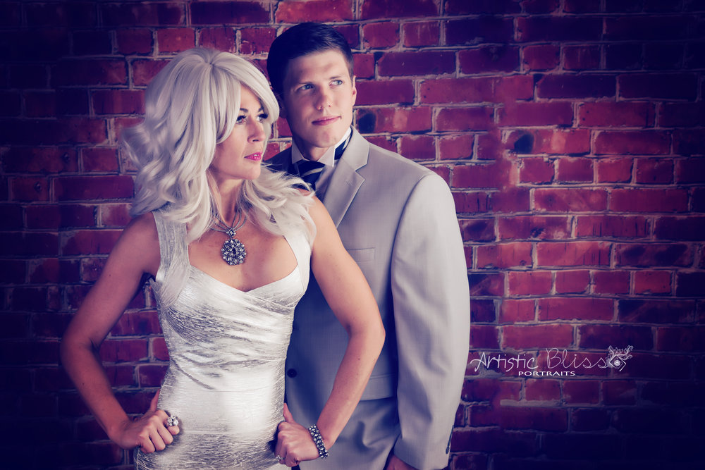 Stunning Couple with brick backdrop