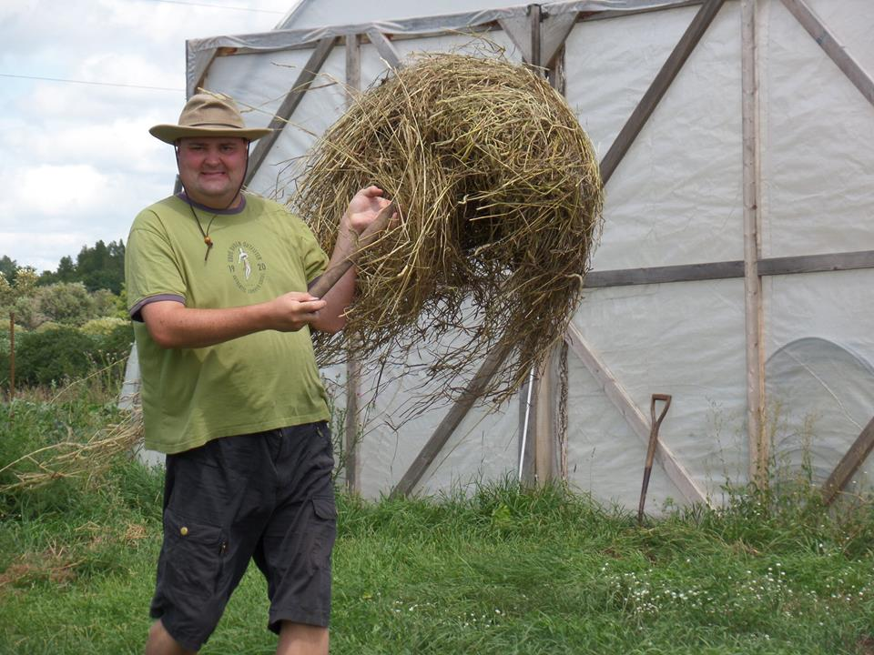 Lee spreading hay on the garden beds