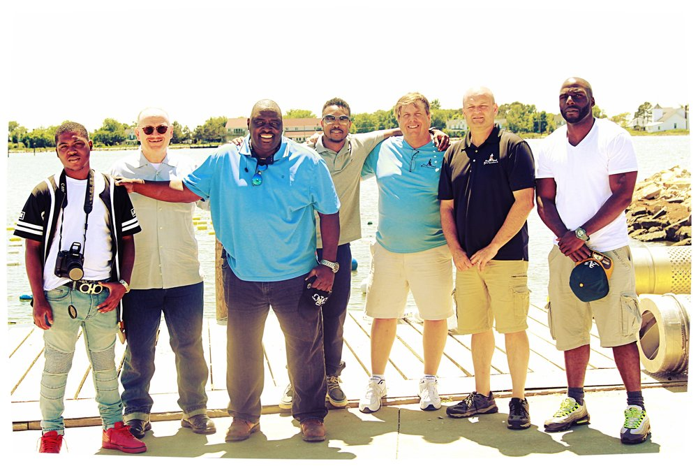 8AC youth, volunteers, and Board posing with oysters inc ceo and team after a tour of their eastern shore operation.