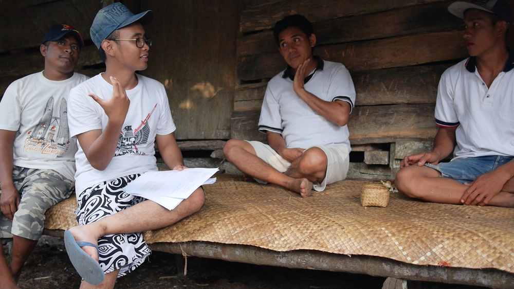 Ridho explaining the survey to a household. Mas Petu (IBEKA Engineer and resident of Kamanggih) was helping us along the way. Shot by Connor
