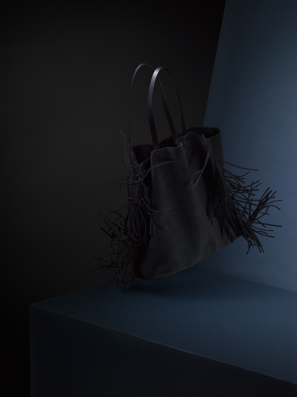 Jonathan shot a beautiful suede fringed tote capturing the natural movement of the bag.