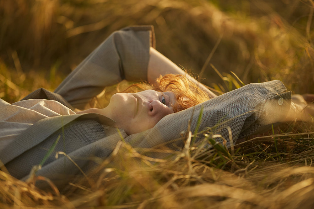 Lying down in autumnal grass menswear story for E Tautz photographed by portrait photographer Chris Floyd represented by photographic agency Flock.jpeg