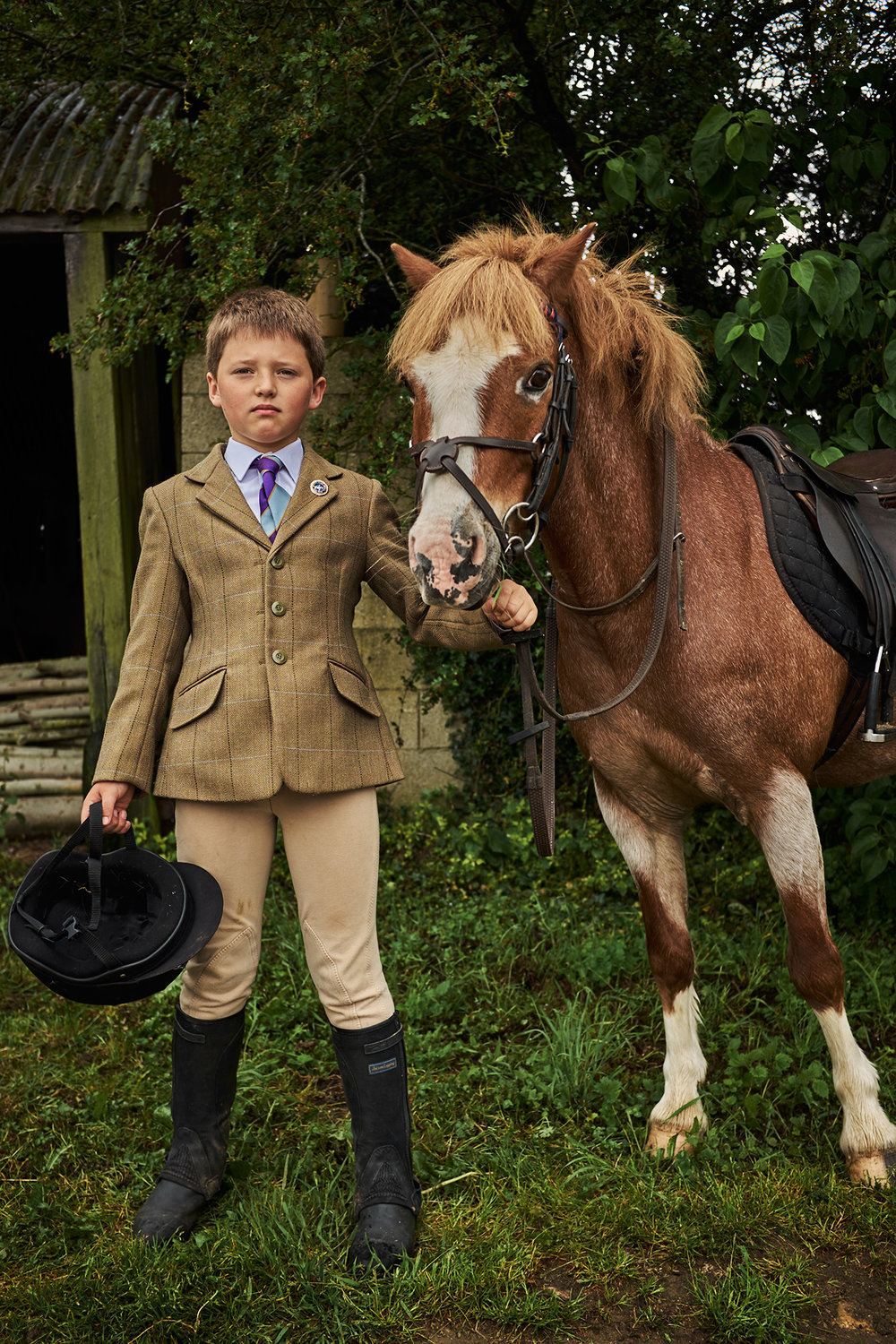 Boy with Pony photographed by Chris Floyd represented by Flock
