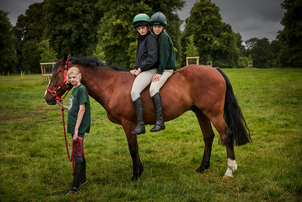 2 girls on a pony at pony club camp photographed by Chris Floyd represented by Flock
