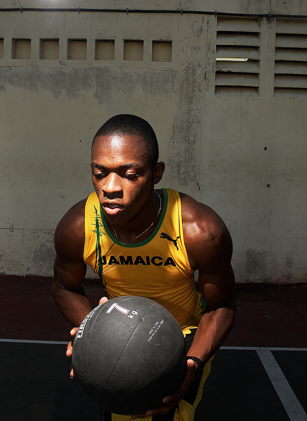 Asafa Powell training photographed by Chris Floyd represented by Flock