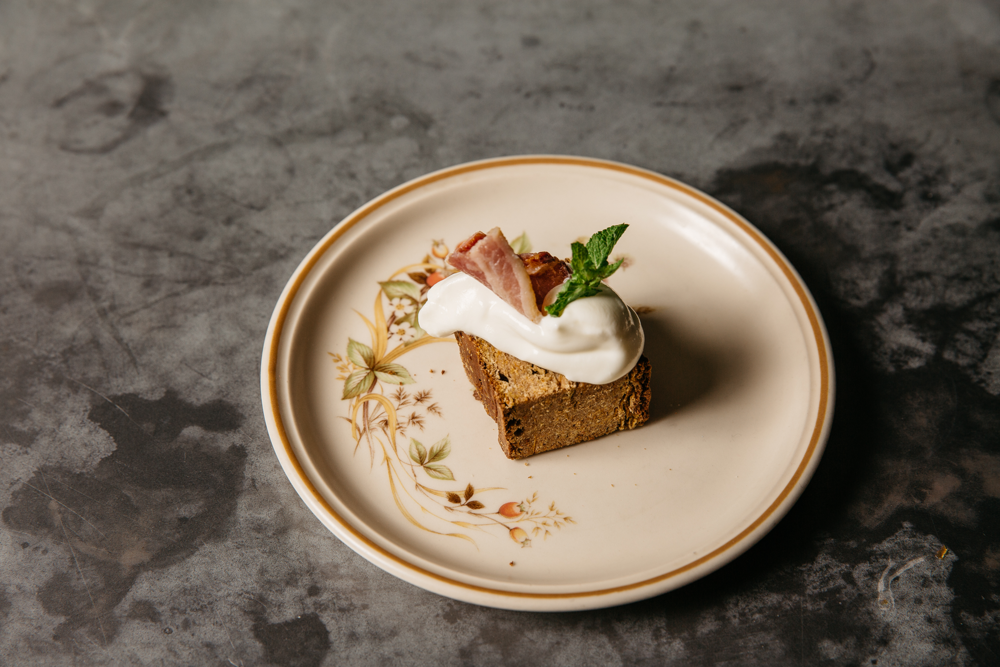 Liver cake with a dollop of yoghurt