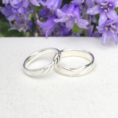 Constance Isobel. Silver carved wedding rings.