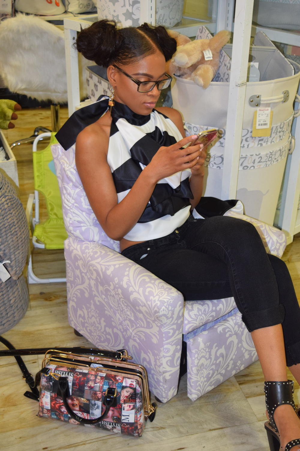 Why did I find this one in the kiddie section sitting in one of the baby chairs texting! Really BritBrat!
