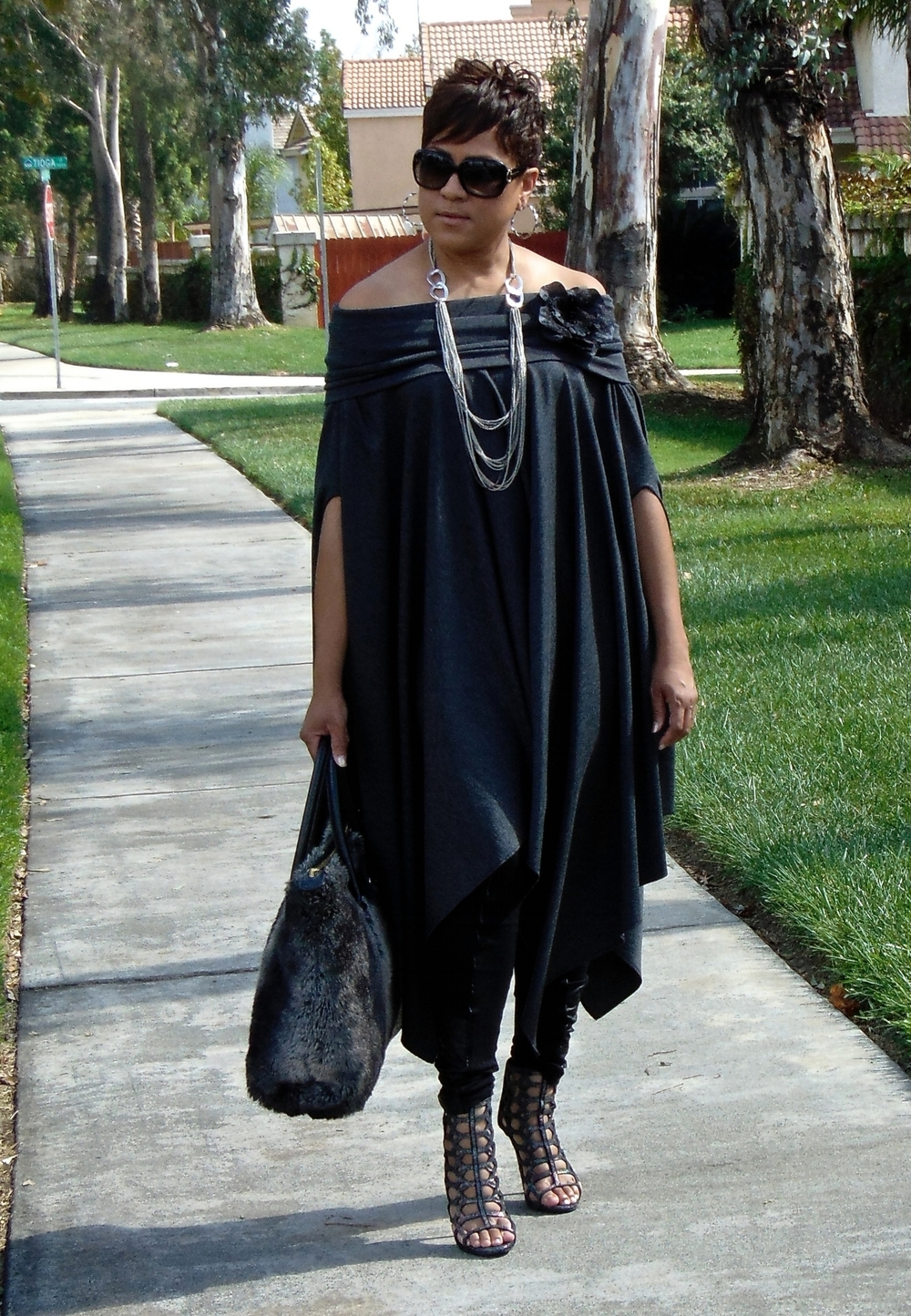 One of my favorite DIY projects Ever! This simple yet chic off the shoulder cape is not only fabulous but easy to make. See DIY & Video page for full details on how to recreate this look.