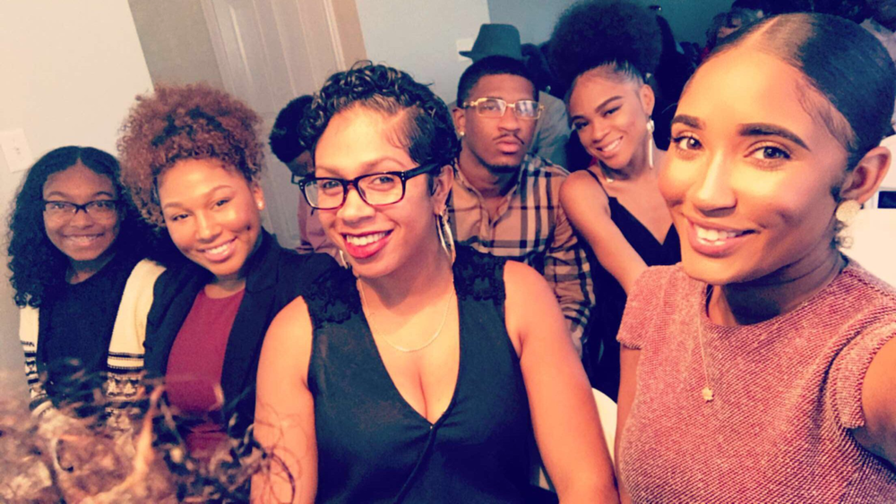 The next generation of grown folks! LOLL Loves these beautiful young people! My baby in the back in black sitting next to her cousin Ryan!