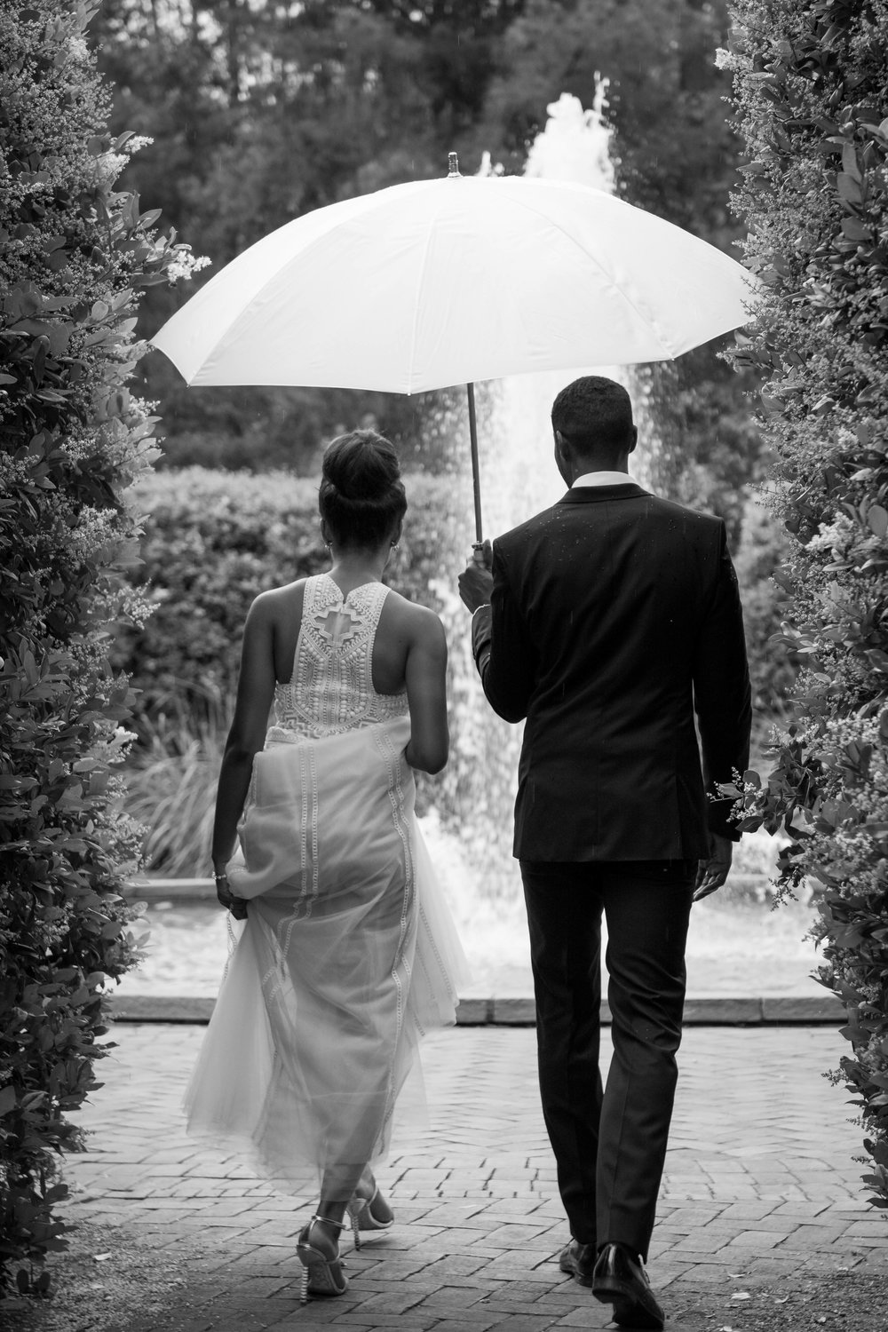 We rock in the rain   Pelting with rain? We can still make you look good and we always have you covered. Seriously we keep wedding umbrellas in our car in case it rains. Also our wet weather guarantee means should it be bucketing down at the time of our location shoot, we will offer you a complimentary 2hr shoot on another day of your choosing.