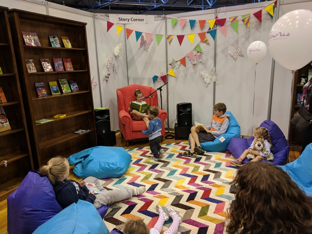 Edie reading a story in the Reading Zone.jpg