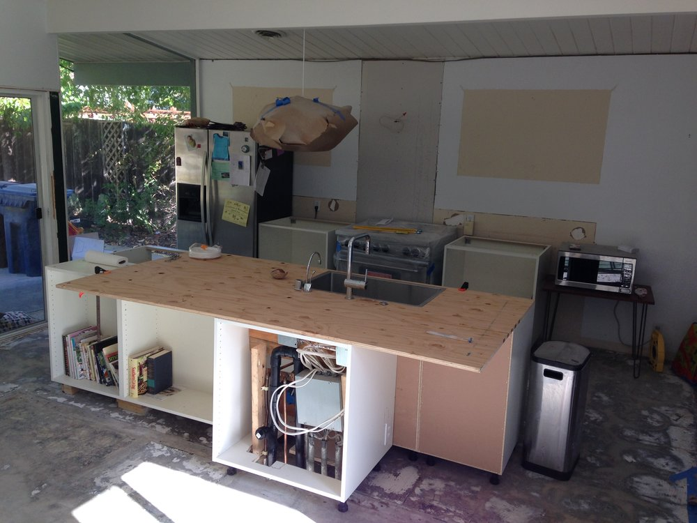 Cabinet boxes in place - plywood surface mounted - enough to get a kitchen sink back into play.